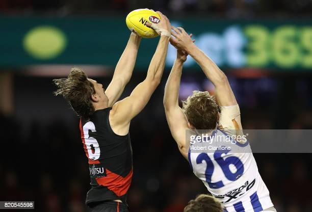 Joe Daniher of the Bombers takes the ball during the round 18 AFL match between the Essendon Bombers and the North Melbourne Kangaroos at Etihad...