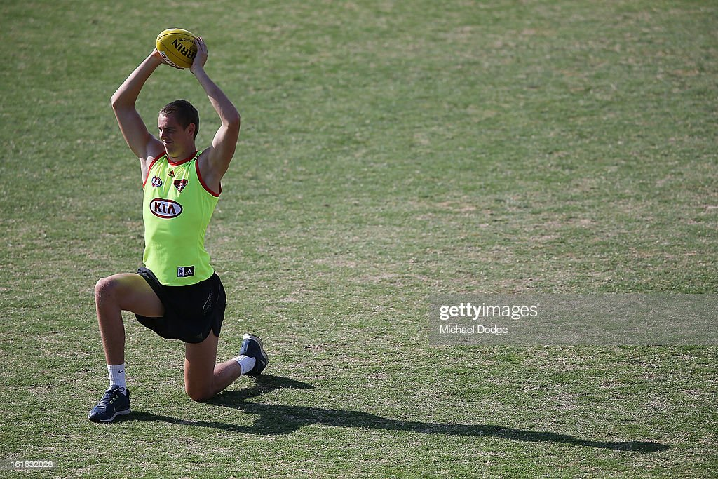 Joe Daniher stretches during a Essendon Bombers AFL training session at Windy Hill on February 14, 2013 in Melbourne, Australia.