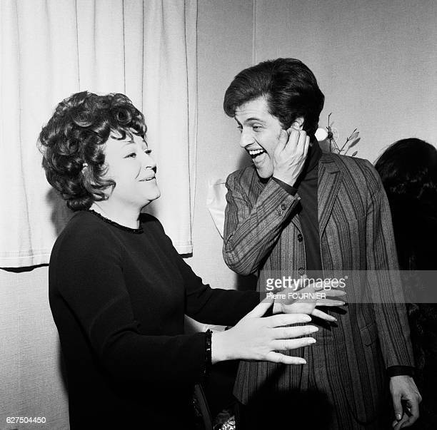 Joe Dassin in his dressing room with Régine at the Olympia music hall