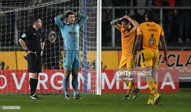 Joe Day of Newport reacts after Plymouth are given their second penalty during extra time during The Emirates FA Cup Second Round Replay between...