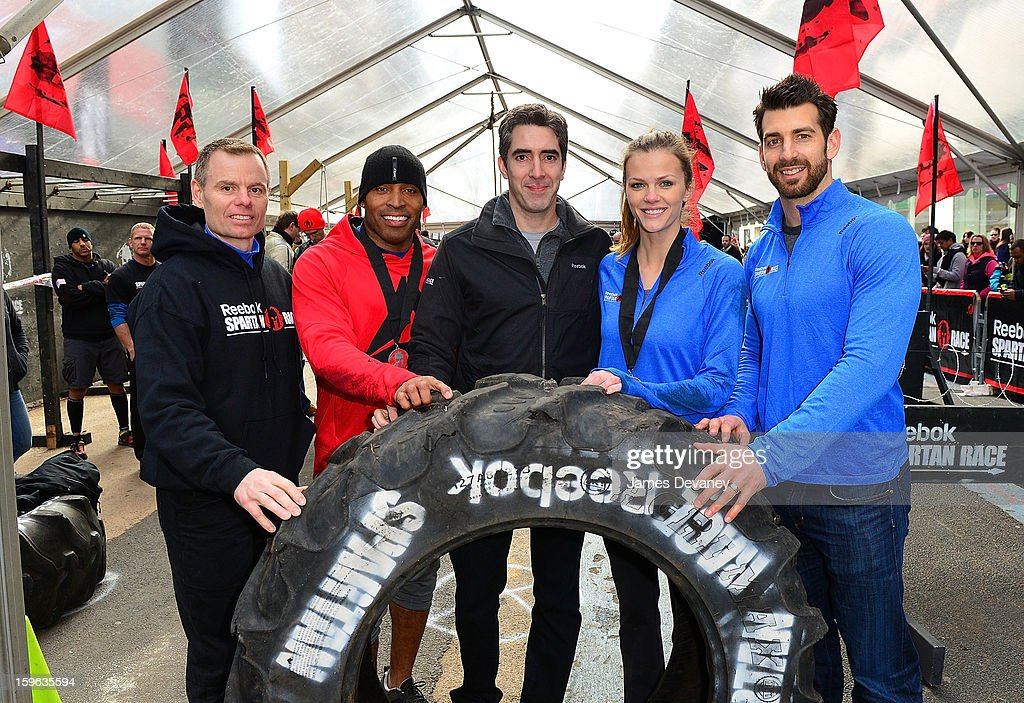 Joe De Sena, Spartan Co-founder, Tiki Barber, Yan Martin, Head of Global Brand Marketing at Reebok, Brooklyn Decker and Chad Wittman, Director of Sports Marketing Fitness and Training at Reebok attend The Reebok Spartan Race Times Square Challenge in Times Square on January 17, 2013 in New York City.