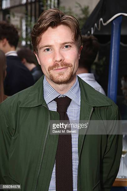Joe Dempsie wearing Dunhill attends the Dunhill summer party to celebrate LCM and the launch of their new eyewear collection at Bourdon House on June...