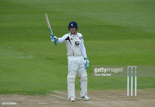 Joe Denly of Kent celebrates reaching his 50 during day one of the Specsavers County Championship Division Two match between Northamptonshire and...