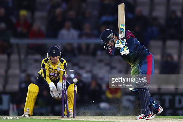Joe Denly of Kent is bowled by Liam Dawson as wicketkeeper Adam Wheater of Hampshire looks on during the NatWest T20 Blast match between Hampshire...