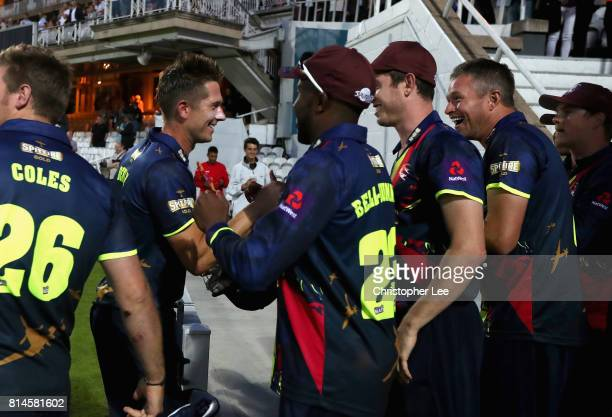 Joe Denly of Kent is congratulated by his team mates after scoring 116 not out and their victory during the NatWest T20 Blast match between Surrey...