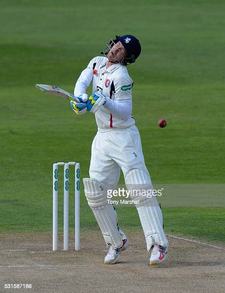 Joe Denly of Kent is struck by a delivery from Olly Stone of Northamptonshire during day one of the Specsavers County Championship Division Two match...