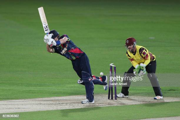 Joe Denly of Kent Spitfires is bowled by Somerset's Max Waller as wicket keeper Steven Davies looks on during the NatWest T20 Blast South Group match...
