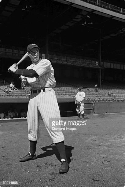 Joe DiMaggio of the New York Yankees poses for a portrait prior to a 1937 game at Yankee Stadium in the Bronx New York