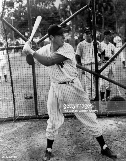 Joe DiMaggio the Yankee Clipper during batting practice to sharpen his eye at the Yankees' training camp circa 1940