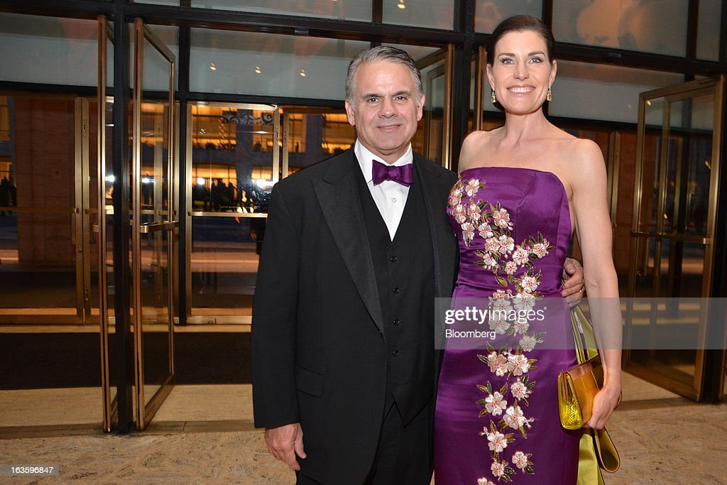 Joe DiMenna of Zweig-Diemmna Associates LLC and Diana DiMenna, a chairman of the School of American Ballet Winter Ball, pose for a photograph during the event at the David H. Koch Theater in New York, U.S., on Monday, March 11, 2013. The School of American Ballet Winter Ball took place at the Lincoln Center. Photographer: Amanda Gordon/Bloomberg via Getty Images