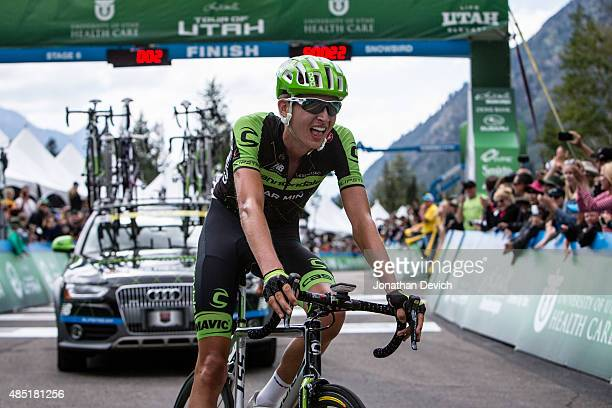 Joe Dombrowski of the CannondaleGarmin Pro Cycling Team crosses the line after winning stage 6 of the Tour of Utah on August 8 2015 in Salt Lake City...