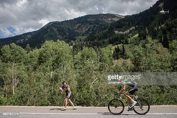 Joe Dombrowski of the CannondaleGarmin Pro Cycling Team gets cheered by a fan on the way to winning stage 6 of the Tour of Utah on August 8 2015 in...