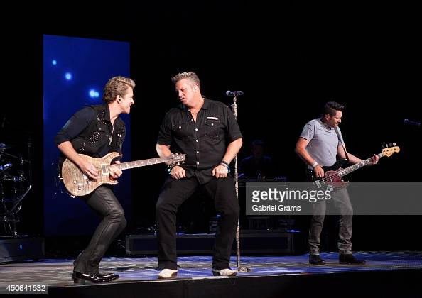 Joe Don Roone Gary LeVox and Jay DeMarcus of Rascal Flatts perform in concert at Tinley Park on June 14 2014 in Chicago Illinois
