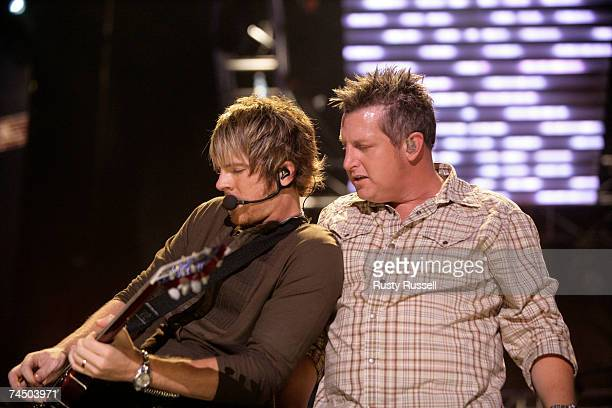 Joe Don Rooney and Gary LaVox of the group Rascal Flatts perform at the CMA Music Festival on June 9 2007 in Nashville Tennessee