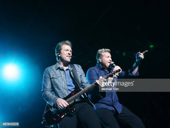 Joe Don Rooney and Gary LeVox of music group Rascal Flatts perform onstage during the 2nd Annual ACM Party for a Cause Festival Day 1 held on April 4...