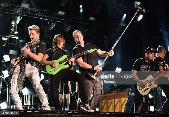 Joe Don Rooney and Gary LeVox of Rascal Flatts perform at LP Field during day 1 of the 2015 CMA Festival on June 11 2015 in Nashville Tennessee