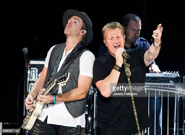 Joe Don Rooney and Gary LeVox of Rascal Flatts perform at Rascal Flatts Rhythm and Roots Tour at Nikon at Jones Beach Theater on September 1 2016 in...