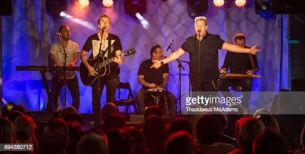 Joe Don Rooney and Gary LeVox of Rascal Flatts perform at Tidal x Rascal Flatts pop up on June 9 2017 in Nashville Tennessee