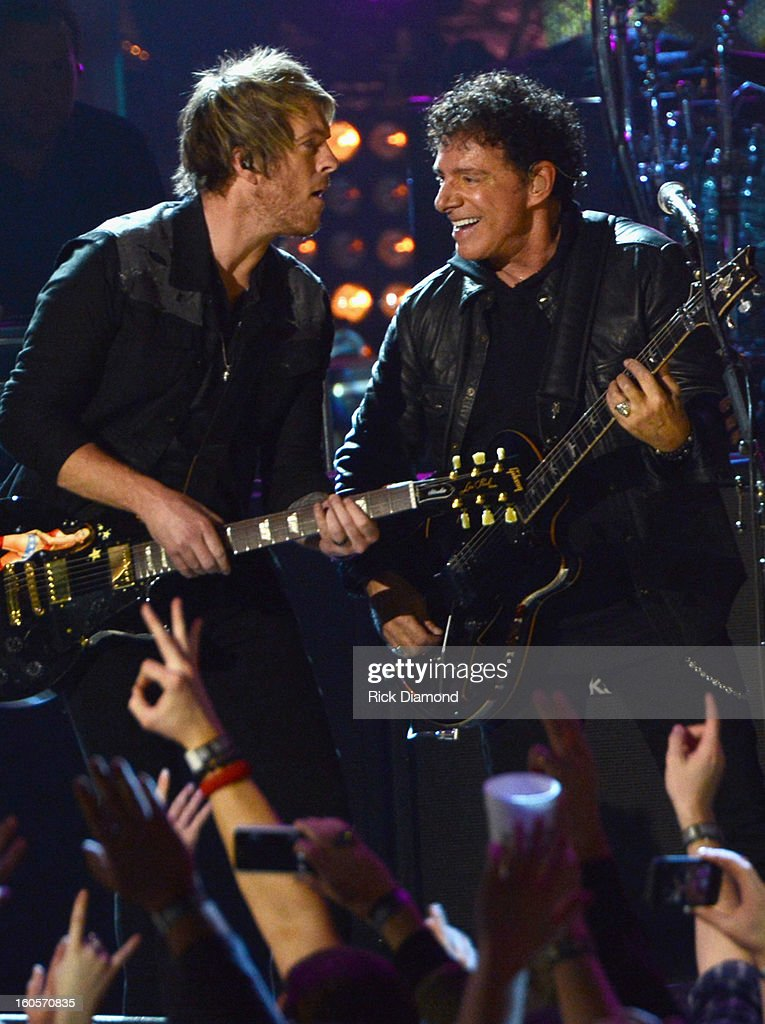 Joe Don Rooney and Neal Schon perform onstage as Journey and Rascal Flatts headline the Super Bowl XLVII CMT Crossroads Concert on February 2, 2013 in New Orleans, Louisiana.