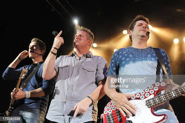 Joe Don Rooney Gary LeVOX and Jay DeMarcus of Rascal Flatts perform on stage in concert at O2 Shepherd's Bush Empire on July 10 2013 in London England