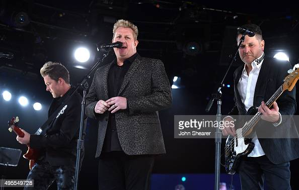 Joe Don Rooney Gary LeVox and Jay DeMarcus of Rascal Flatts perform onstage during the BMI 2015 Country Awards at BMI on November 3 2015 in Nashville...