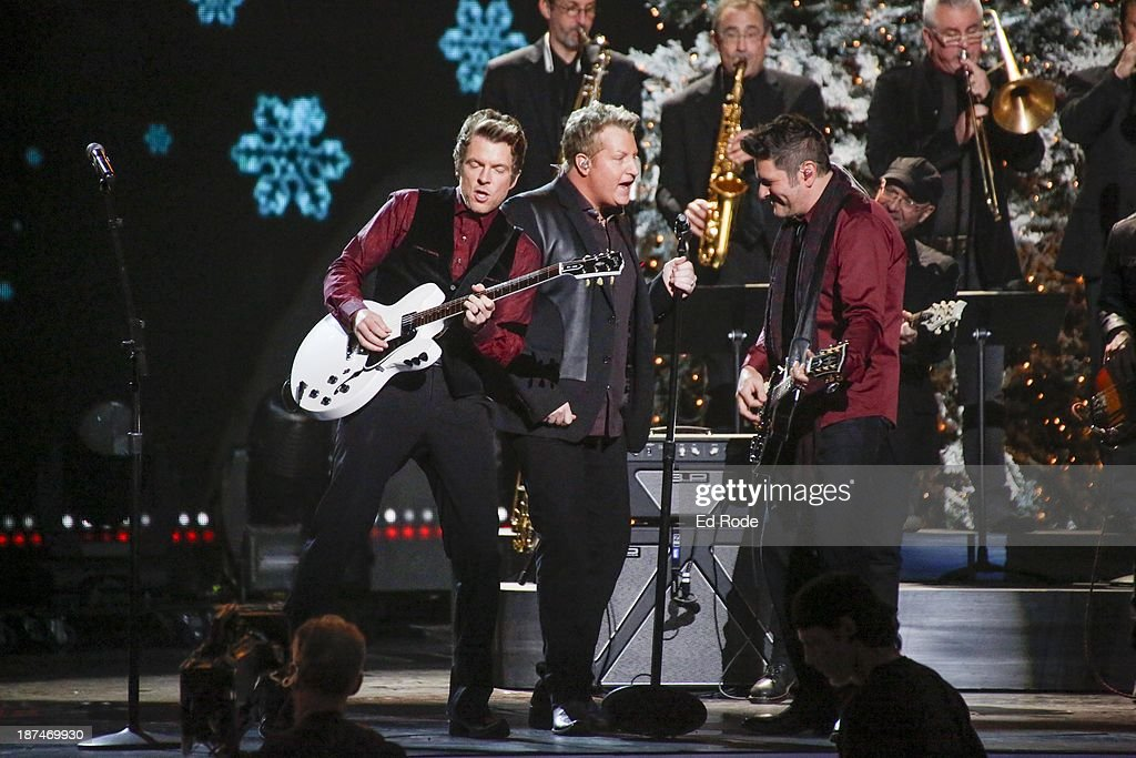 <a gi-track='captionPersonalityLinkClicked' href=/galleries/search?phrase=Joe+Don+Rooney&family=editorial&specificpeople=241526 ng-click='$event.stopPropagation()'>Joe Don Rooney</a>, Gary LeVox and <a gi-track='captionPersonalityLinkClicked' href=/galleries/search?phrase=Jay+DeMarcus&family=editorial&specificpeople=224578 ng-click='$event.stopPropagation()'>Jay DeMarcus</a> performs during the CMA 2013 Country Christmas on November 8, 2013 in Nashville, Tennessee.