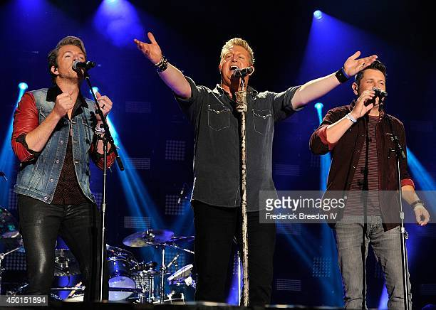 Joe Don Rooney Gary LeVox and of the band Rascal Flatts performs at LP Field at the 2014 CMA Festival on June 5 2014 in Nashville Tennessee
