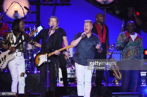 Joe Don Rooney Gary LeVox Jay DeMarcus of Rascal Flatts perform onstage with Verdine White Philip Bailey of Earth Wind Fire during CMT Crossroads...