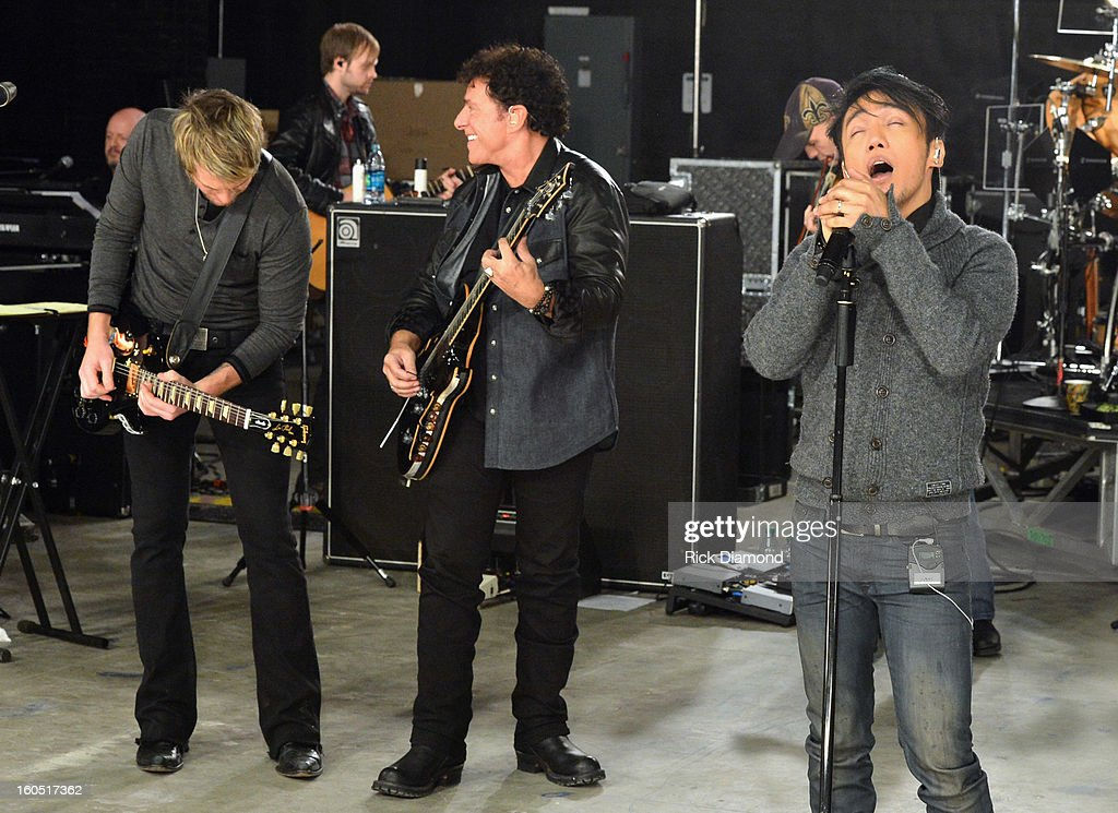 Joe Don Rooney, Neal Schon and Arnel Pineda perform during CMT Crossroads: Journey and Rascal Flatts Live from Super Bowl XLVII rehearsals on February 1, 2013 in New Orleans, Louisiana.