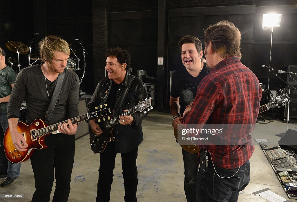 Joe Don Rooney, Neal Schon, Jay DeMarcus and Jonathan Cain perform during CMT Crossroads: Journey and Rascal Flatts Live from Super Bowl XLVII rehearsals on February 1, 2013 in New Orleans, Louisiana.