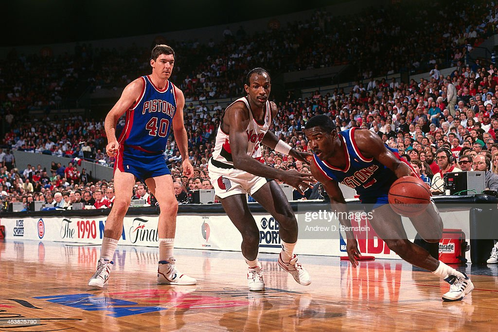 Joe Dumars of the Detroit Pistons dribbles against Clyde Drexler of the Portland Trail Blazers during the 1990 NBA Finals circa 1990 at the Veterans...