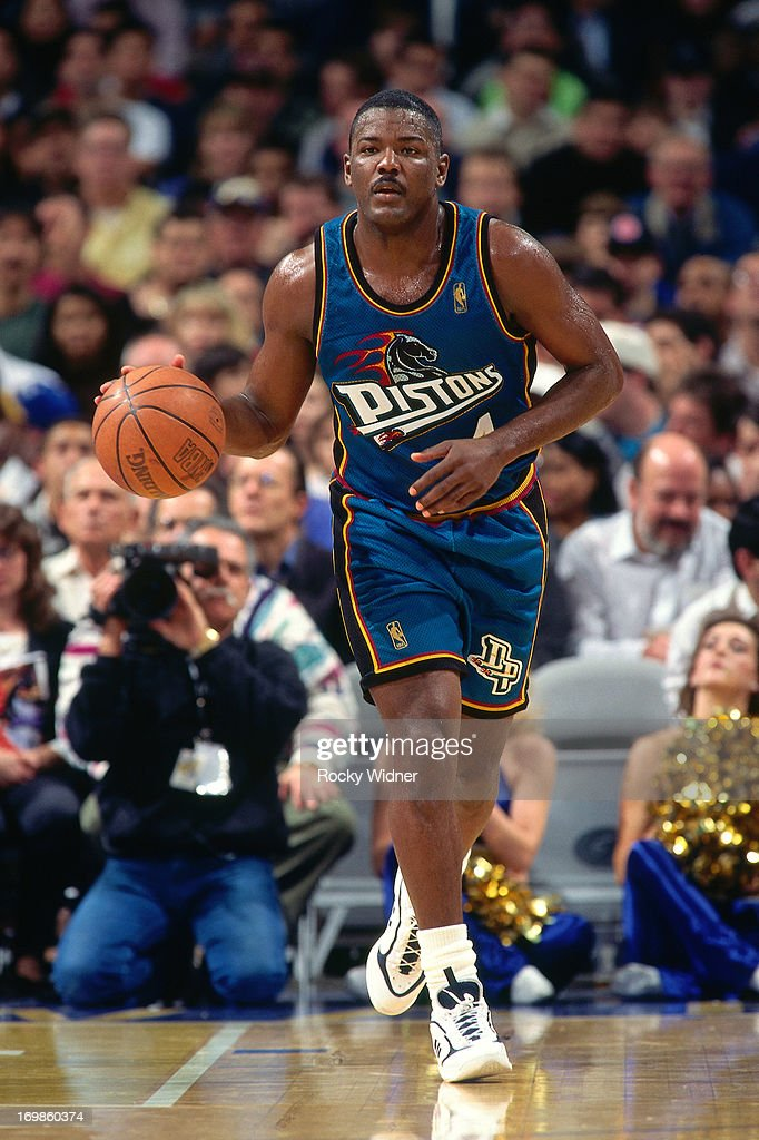 Joe Dumars of the Detroit Pistons dribbles the ball against the Golden State Warriors during a game played on January 23 1997 at the San Jose Arena...
