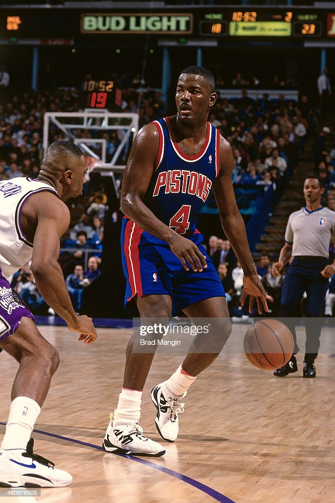 Joe Dumars of the Detroit Pistons dribbles the ball against the Sacramento Kings during a game played circa 1995 at the Oakland Coliseum in Oakland...