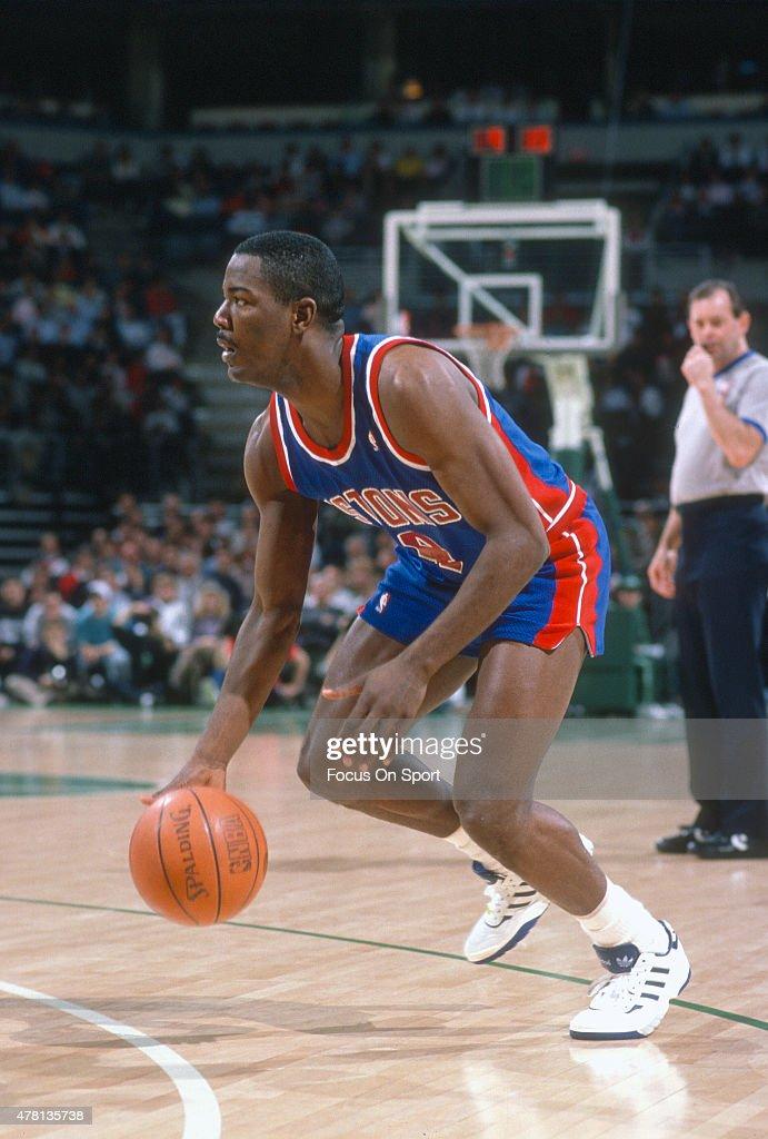 Joe Dumars of the Detroit Pistons dribbles the ball against the Milwaukee Bucks during an NBA basketball game circa 1990 at The Bradley Center in...