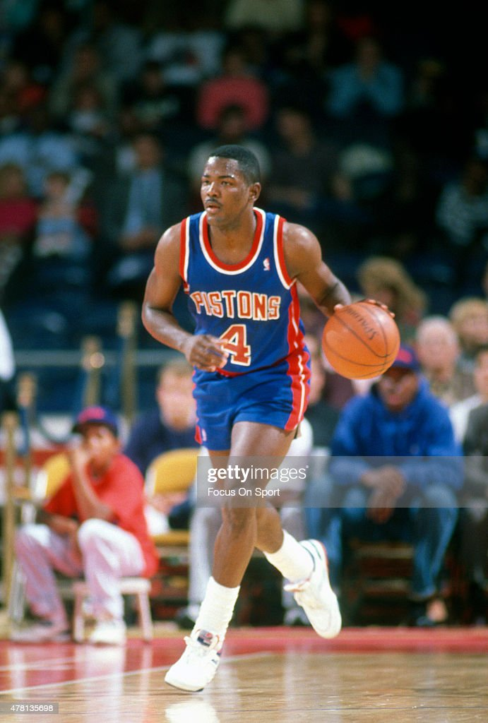 Joe Dumars of the Detroit Pistons dribbles the ball up court against the Washington Bullets during an NBA basketball game circa 1990 at The Capital...