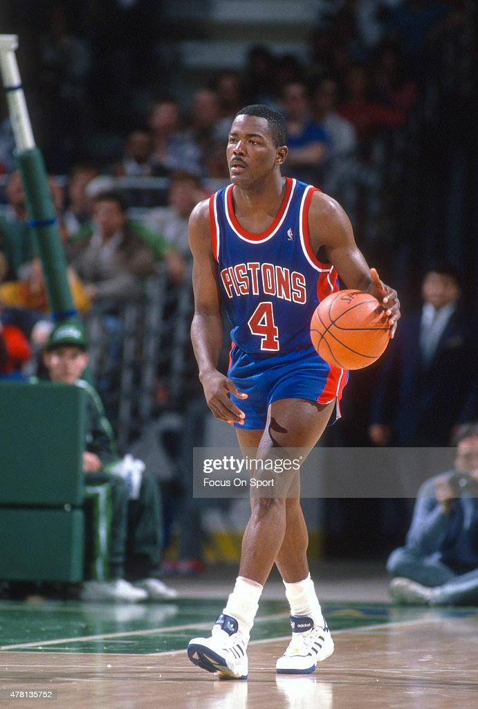 Joe Dumars of the Detroit Pistons dribbles the ball up court against the Milwaukee Bucks during an NBA basketball game circa 1990 at The Bradley...