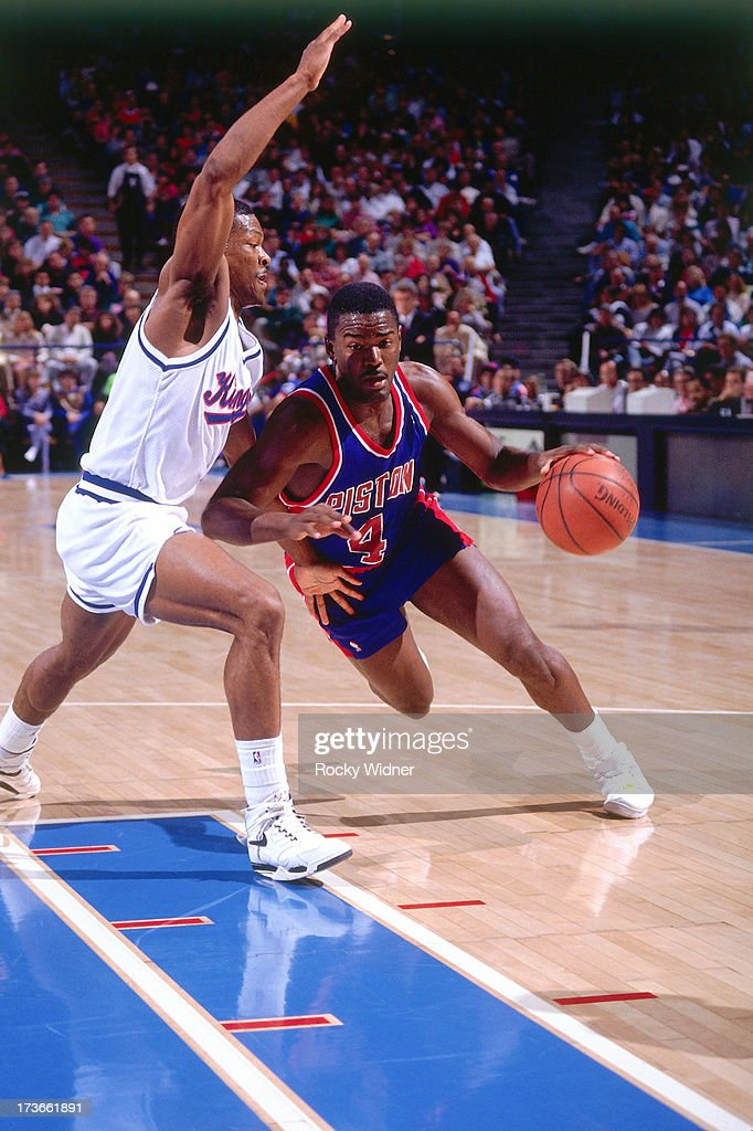 Joe Dumars of the Detroit Pistons drives against Travis Mays of the Sacramento Kings during a game played on December 8 1990 at Arco Arena in...