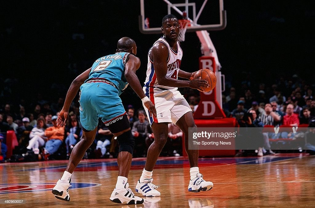 joe-dumars-of-the-detroit-pistons-drives-the-ball-past-greg-anthony-picture-id492953007
