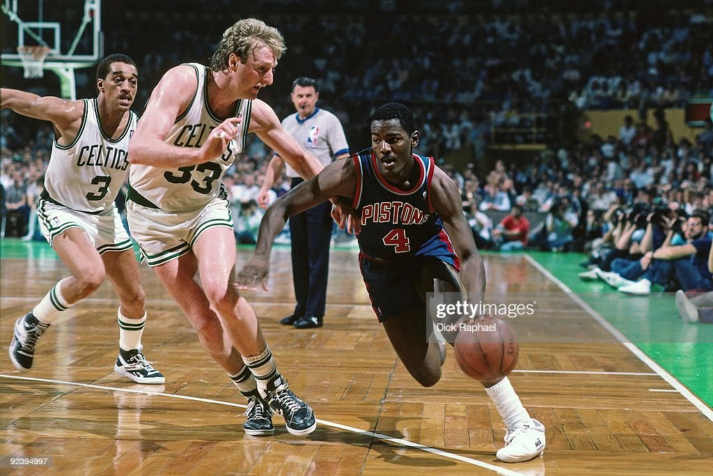 Joe Dumars of the Detroit Pistons drives to the basket against Larry Bird of the Boston Celtics during a game played in 1987 at the Boston Garden in...