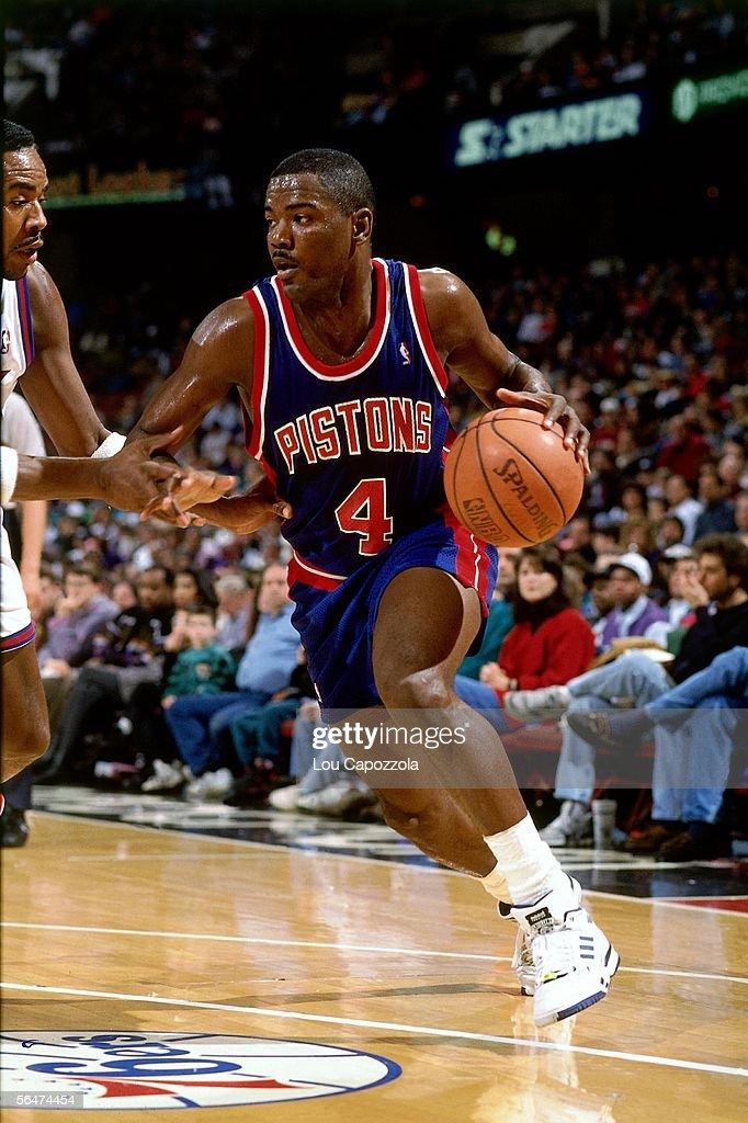 Joe Dumars of the Detroit Pistons drives to the basket against the Philadelphia 76ers during a 1993 NBA game at the Spectrum in Philadelphia...