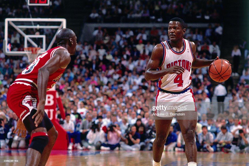 Joe Dumars of the Detroit Pistons handles the ball against Michael Jordan of the Chicago Bulls circa 1990 at the Palace of Auburn Hills in Auburn...