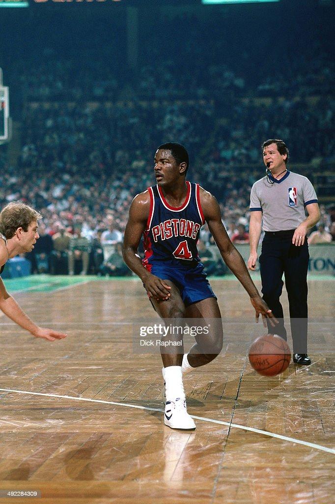 Joe Dumars of the Detroit Pistons handles the ball against the Boston Celtics during a game circa 1986 at the Boston Garden in Boston Massachusetts...