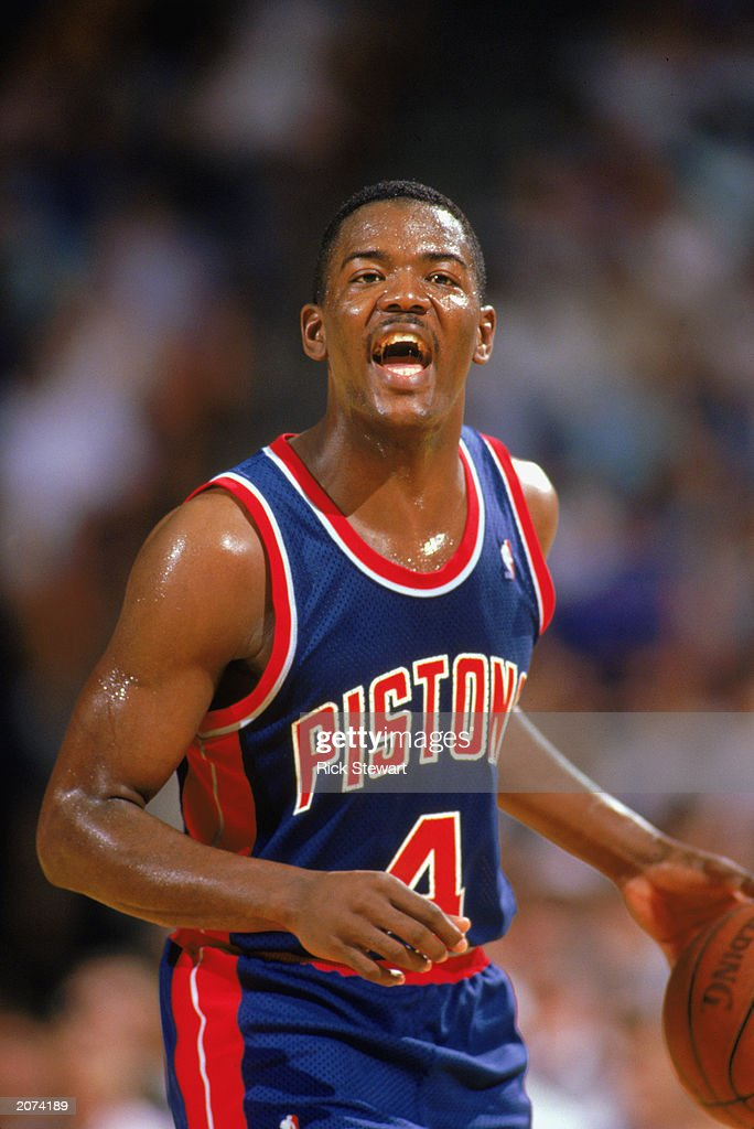 Joe Dumars of the Detroit Pistons moves the ball during a game in the 19871988 NBA season