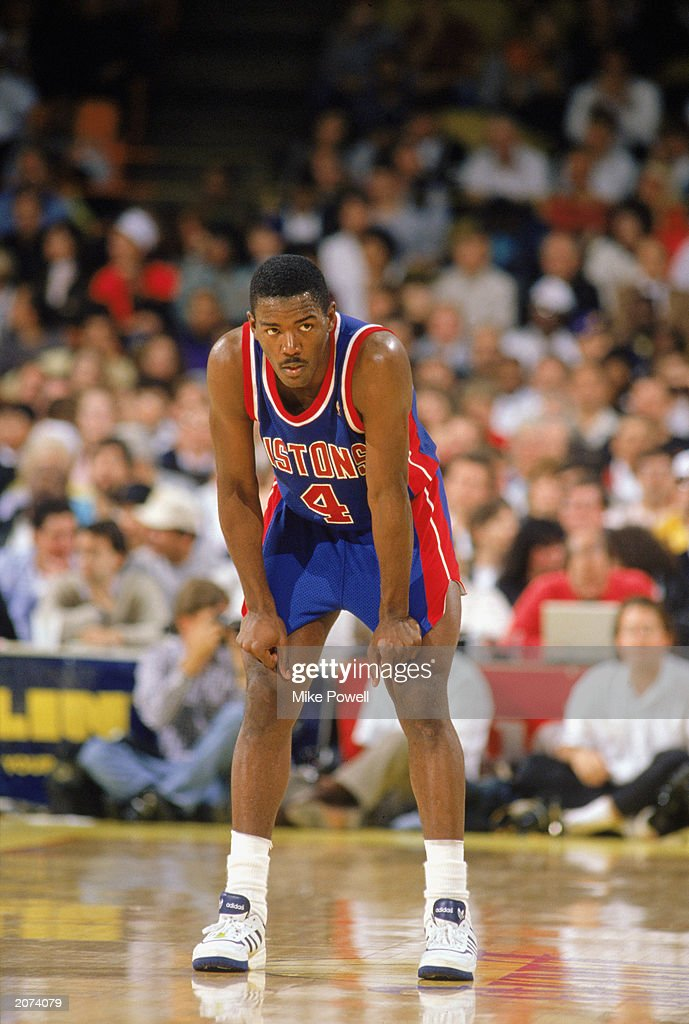 Joe Dumars of the Detroit Pistons rests during a game in the 19891990 NBA season