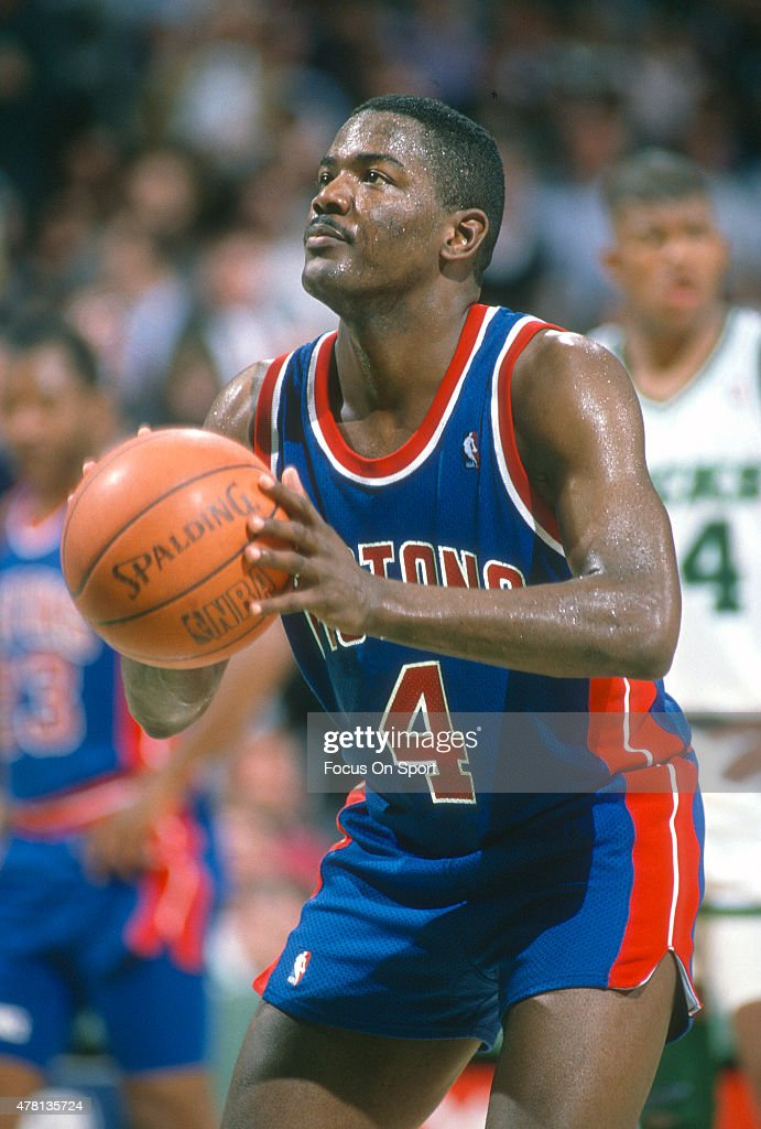 Joe Dumars of the Detroit Pistons sets to shoot a free throw against the Milwaukee Bucks during an NBA basketball game circa 1990 at The Bradley...