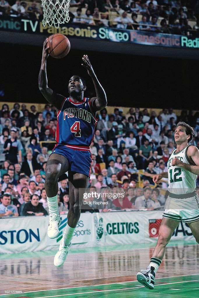 Joe Dumars #4 of the Detroit Pistons shoots a layup against the Boston Celtics during a game played in 1987 at the Boston Garden in Boston, Massachusetts.