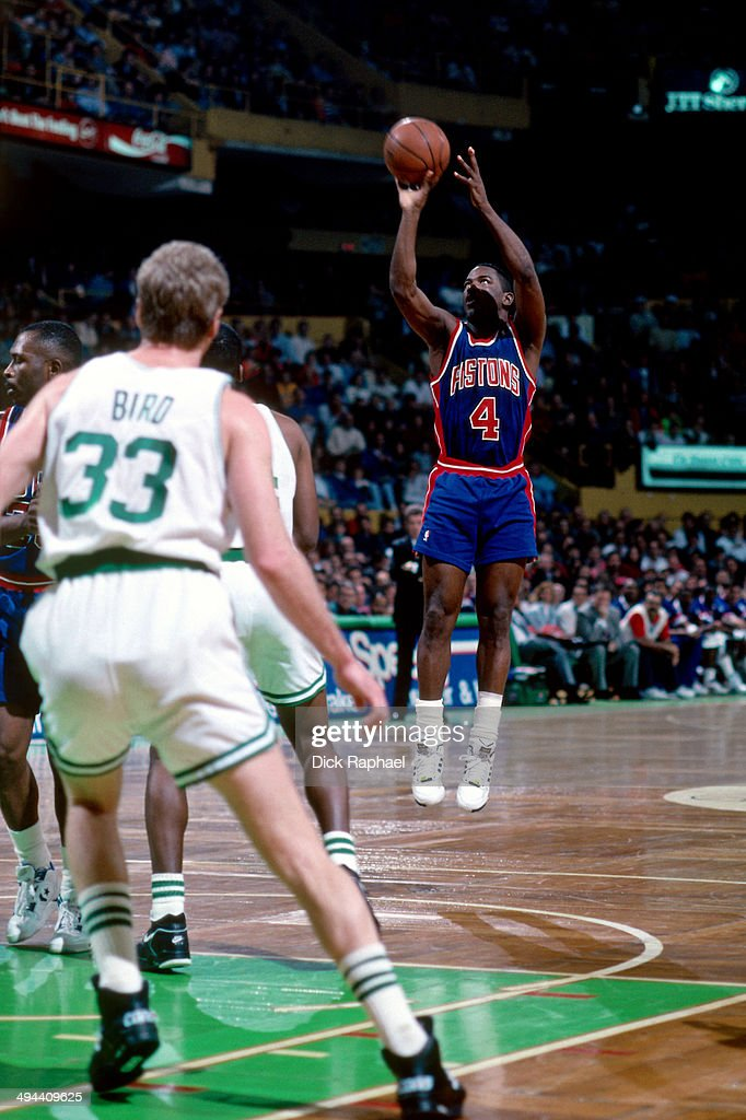 Joe Dumars of the Detroit Pistons shoots against the Boston Celtics during a game played in 1992 at the Boston Garden in Boston Massachusetts NOTE TO...