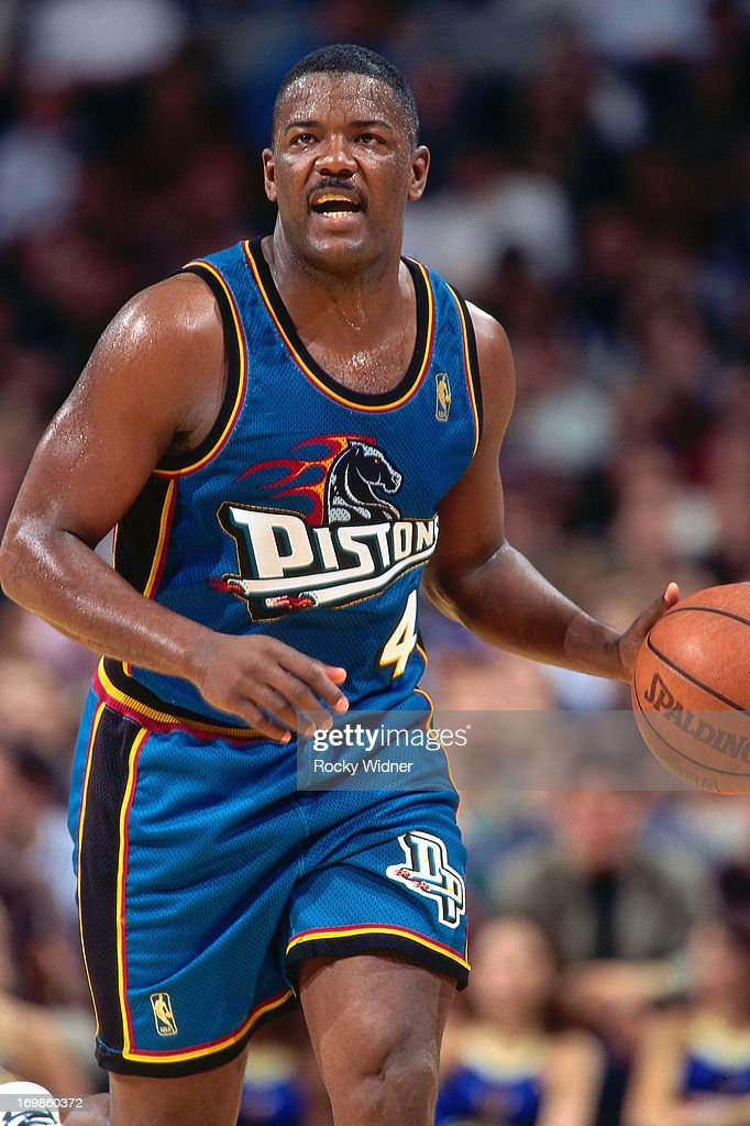 Joe Dumars of the Detroit Pistons shoots the ball against the Golden State Warriors during a game played on January 23 1997 at the San Jose Arena in...