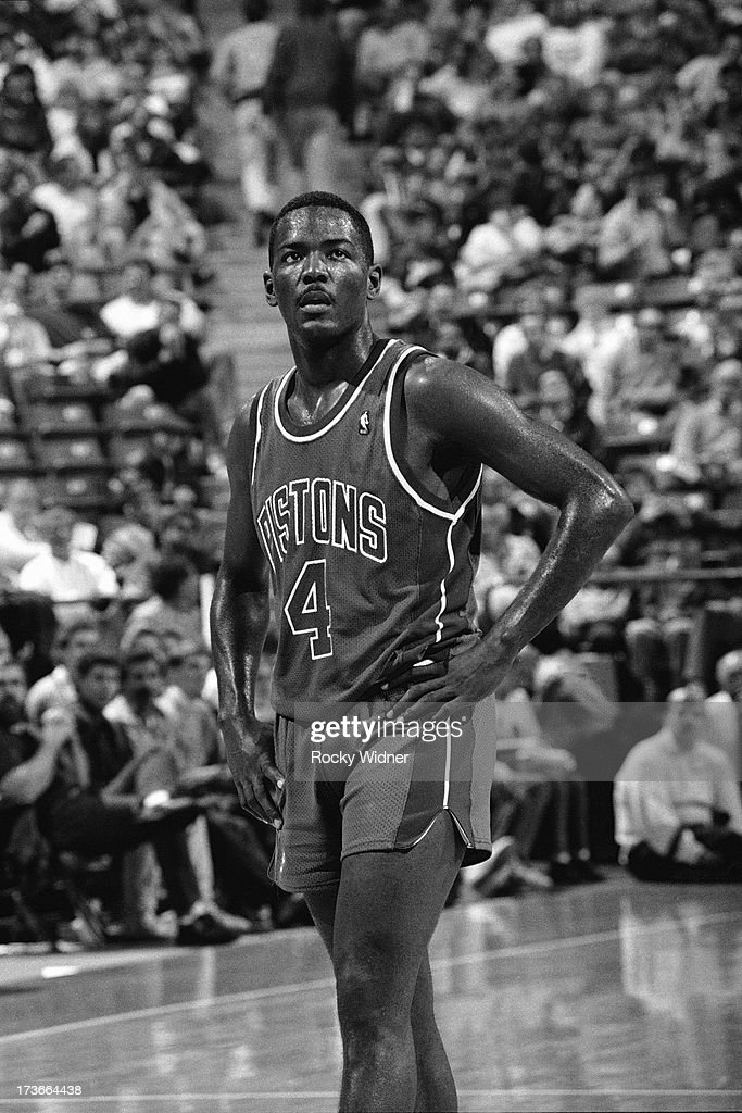 Joe Dumars of the Detroit Pistons waits to resume play against the Sacramento Kings during a game played on November 28 1989 at Arco Arena in...