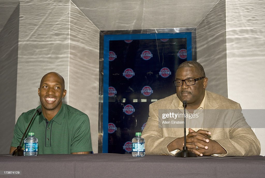 Joe Dumars, President of Basketball Operations (R), introduces new Detroit Piston, Chauncey Billups, at a press conference at Palace of Auburn Hills on July 16, 2013 at Palace of Auburn Hills in Auburn Hills, Michigan.
